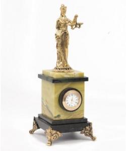 Часы изофиокальцита измеевика сфемидой из бронзы.
